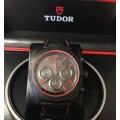 W#T000 Tudor (made by Rolex)  red & black PVD on strap model Black  Sheild  #42000CR  brand new / never worn (complete set ) retails for $5050.00 asking $3535.00