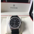 W#T00 Men's stainless steel Tudor (made by Rolex ) Glamour black diamond dial / diamond bezel on black leather strap - brand new / never worn (complete set) -retails for $5500.00 asking $3850.00