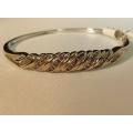 "B#24 10k two tone bangle bracelet  1.00ct total in diamonds  7.7 dwt 2.5"" across  Asking $795.00"