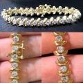 B# 14k y gold and diamond link bracelet
