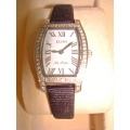 WW#10 LADIES STAINLESS STEEL ELINI WATCH WITH DIAMONDS $750.00