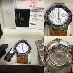 W#47Universal Tri-compact Stainless Steel  Black and brown leather straps  Stainless Steel bracelet  Boxes, papers, books $2,495.00