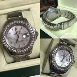W#09 Rolex Yacht Master  Stainless Steel 40mm Custom bezel and mother of pearl diamond dial  $8,995.00